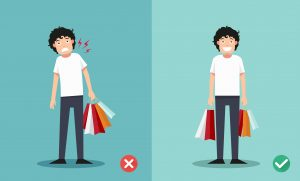 illustration showing neck pain when carrying all the bags in one hand. But happy when evenly balanced