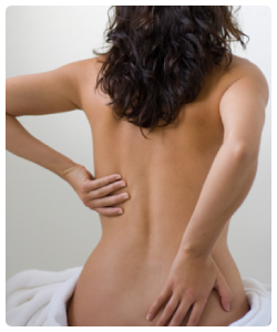 Woman holding her back due to low back pain